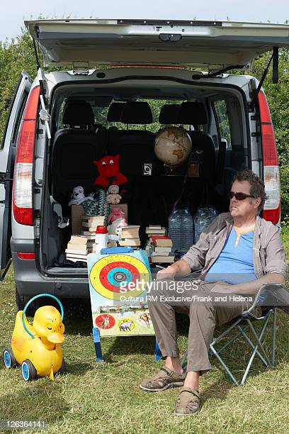 Man selling toys from car trunk