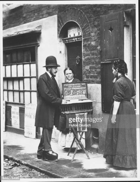 A man sells a cough preventative on the side of a road in a scene from the book 'Street Life in London' by John Thomson FRGS and Adolphe Smith