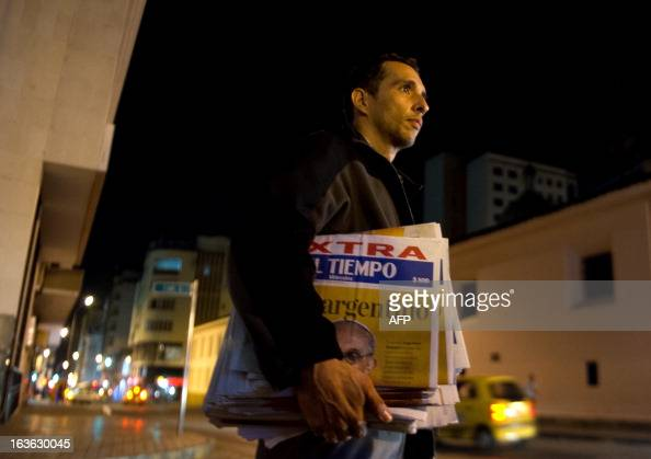 A man sells an extra edition of a newspaper with the announcement of the the election of Argentina's cardinal Jorge Mario Bergoglio as the new Pope...