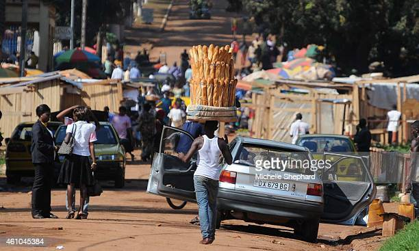 A man sells bread on the streets of the capital as life returns to the capital under the protection of United Nations and French forces