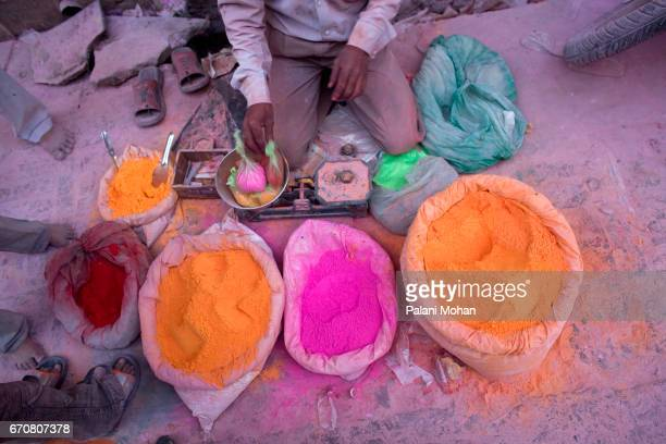 A man sells colourful power as part of Holi the festival of colour at the Sri Banke Bihari Temple March 22 2008 in Vrindavan India Holi is celebrated...