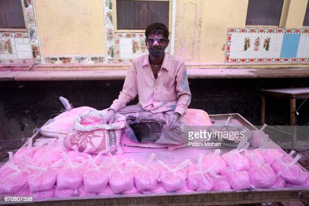 A man sells colourful power as part of Holi the festival of colour on March 22 2008 at the Sri Banke Bihari Temple in the ancient town of Vrindavan...