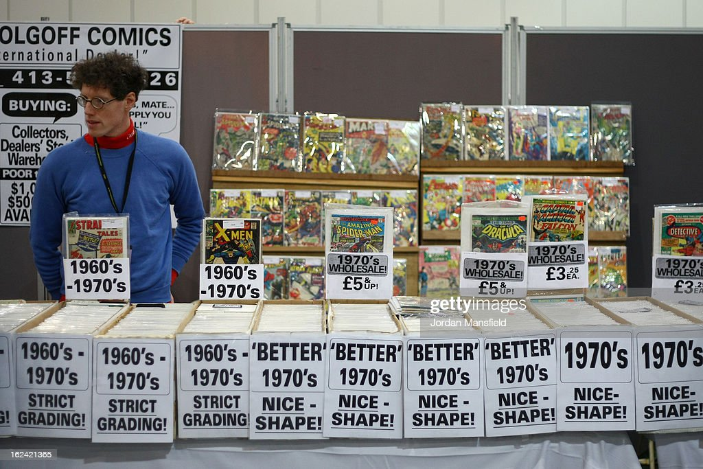 A man sells comics from a stall during the London Super Comic Convention at the ExCeL Centre on February 23, 2013 in London, England. Enthusiasts at the Comic Convention are encouraged to wear a costume of their favourite comic character and flock to the ExCeL to gather all the latest news in the world of comics, manga, anime, film, cosplay, games and cult fiction.