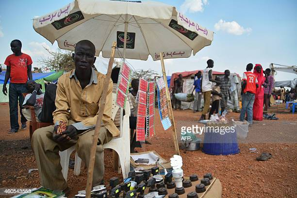 A man sells credit cards for phones and charges phone batteries at the internally displaced persons' camp of the United Nations Mission in South...