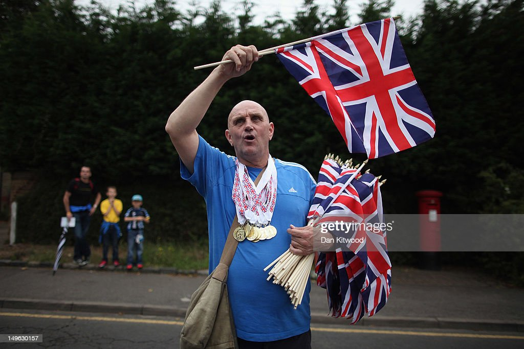 A man sells flags to spectators ahead of the Men's Individual Time Trial Road Cycling on day 5 of the London 2012 Olympic Games on August 1, 2012 in London, England.