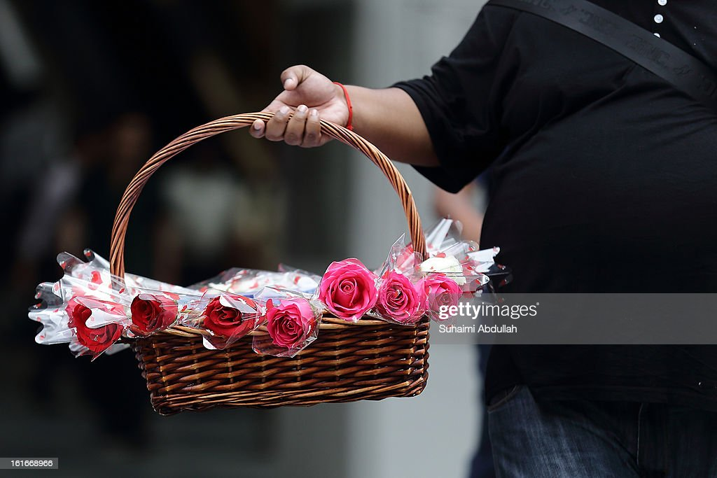 A man sells flowers during Valentine's Day at Raffles Place on 14 February, 2013 in Singapore. Valentine's Day is a time to celebrate love, romance and friendship and is celebrated worldwide annually in different ways on February 14.