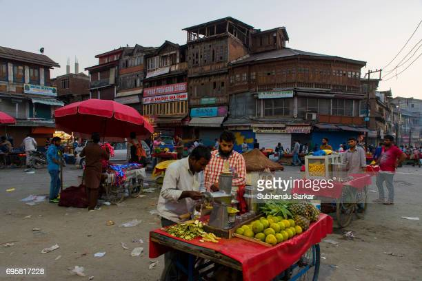 A man sells fruits at Lal Chowk in Kashmir