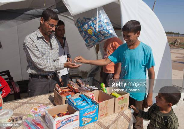 A'ZAZ ALEPPO SYRIA A man sells goods at the Syrian refugee camp near the border with Turkey in A'zaz Syria