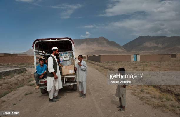 A man sells ice cream to local children in the mostly abandoned land allocation settlement of AliceGhan about 30 miles outside of Kabul Afghanistan...