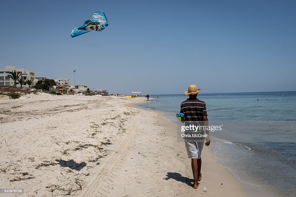 A man sells kites along the beach on June 25, 2016 in Sousse, Tunisia. Before the 2011 revolution, tourism in Tunisia accounted for approximately 7% of the countries GDP. The two 2015 terrorist attacks at the Bardo Museum and Sousse Beach saw tourism numbers plummet even further forcing hotels to close and many tourism and hospitality workers to lose their jobs. The 26th of June marks the first anniversary of the Sousse beach attacks.