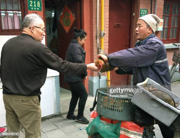 A man sells live birds on the streets of Shanghai in January 2017 an act that has been prohibited amid the spread of the H7N9 avian flu virus...