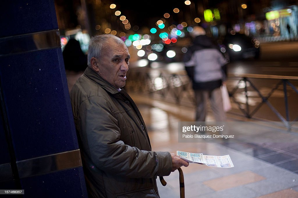 A man sells lotery tickets on the street on December 3, 2012 in Madrid, Spain. Spain has formally requested 39.5 billion euros of European funds to bailout a number of its struggling banks.