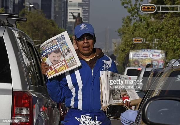 A man sells newpapers in Mexico City on July 13 reading about Mexican drug lord Joaquin 'El Chapo' Guzman's escape from the Altiplano prison Mexican...