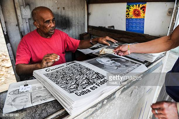 A man sells newspapers in Havana on November 27 two days after Cuban revolutionary leader Fidel Castro died Cuban revolutionary icon Fidel Castro...