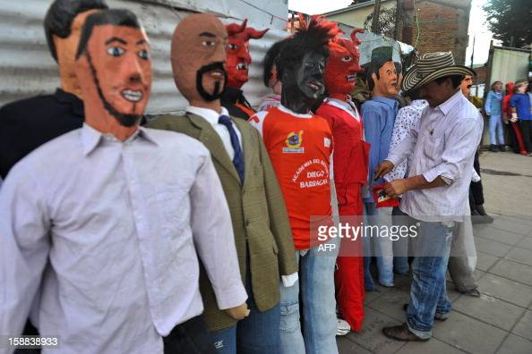 A man sells 'Old Year' dolls in the streets of Cali Colombia on December 31 2012 It is a popular tradition in Colombia to burn 'Old Year' dolls on...