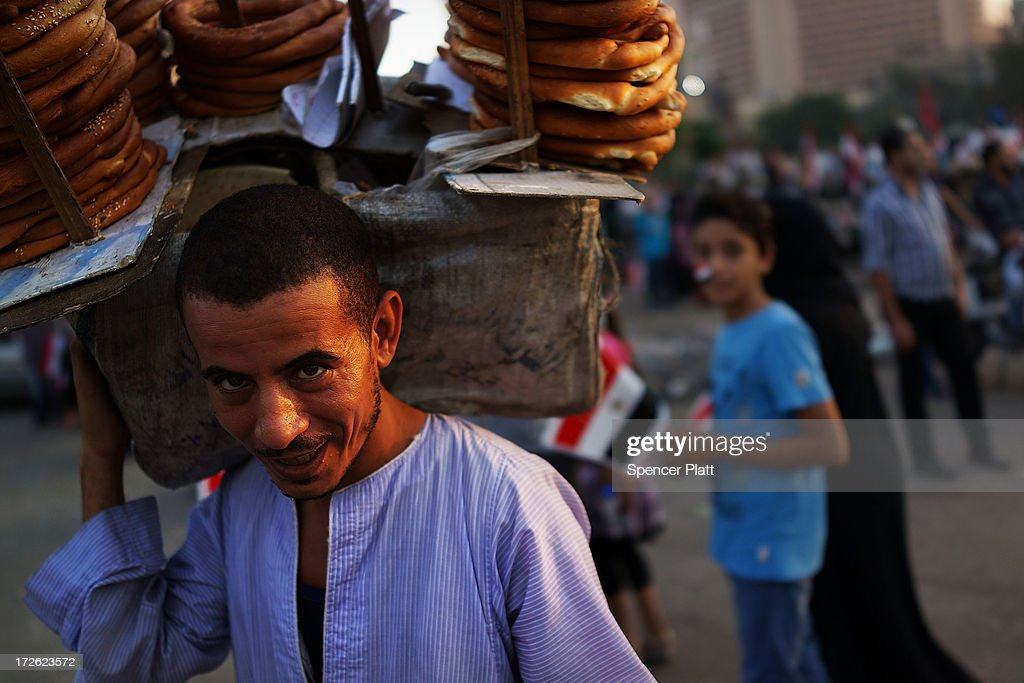A man sells pretzels in Tahrir Square, the day after former Egyptian President Mohammed Morsi, the country's first democratically elected president, was ousted from power on July 4, 2013 in Cairo, Egypt. Adly Mansour, chief justice of the Supreme Constitutional Court, was sworn in as the interim head of state in ceremony in Cairo in the morning of July 4, the day after Morsi was placed under house arrest by the Egyptian military and the Constitution was suspended.