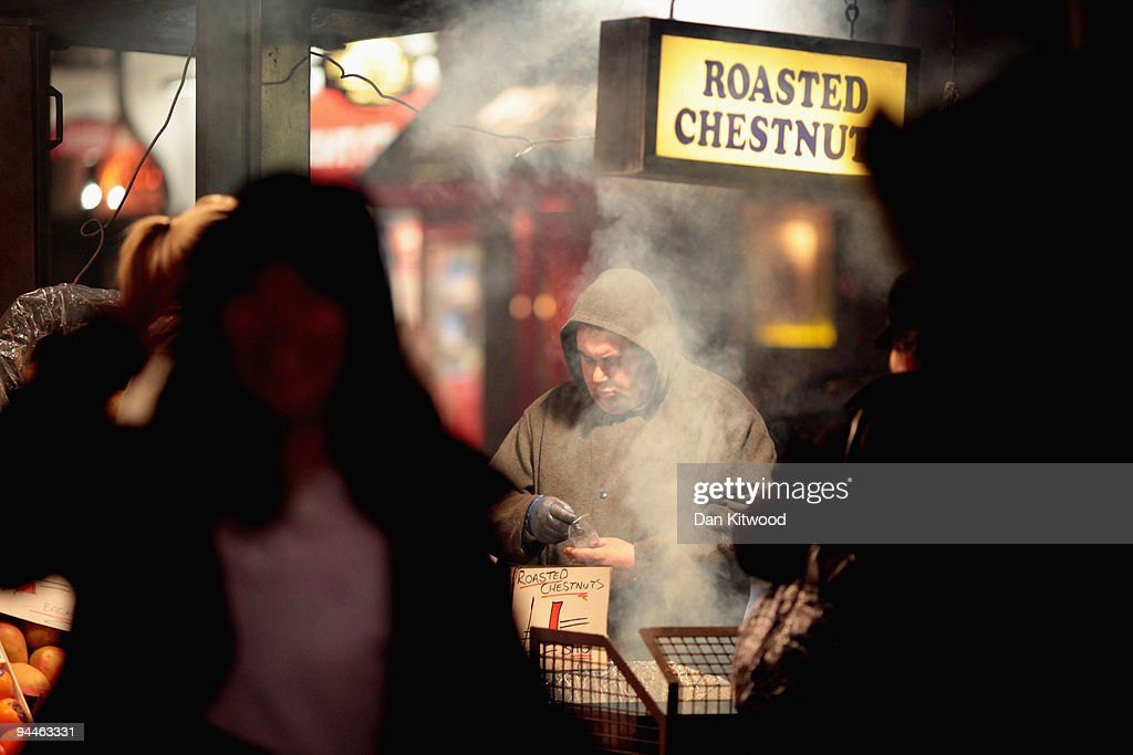 A man sells roasted chestnuts on Oxford Street on December 14, 2009 in London, England. High street stores are expecting a bumper Christmas this year despite the economic dowturn, with shoppers spending around GBP £120 million in the past two days alone.