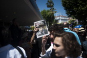 A man sells the Liberation newspaper with on its front page a photo of the head of the International Monetary Fund Dominique StraussKahn during the...