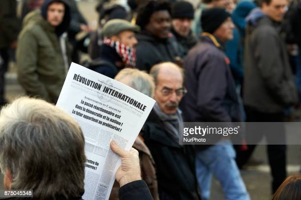 A man sells to protesters a newspaper called 'International revolution' with headlines on Catalonia More than 4000 protesters took to the streets of...