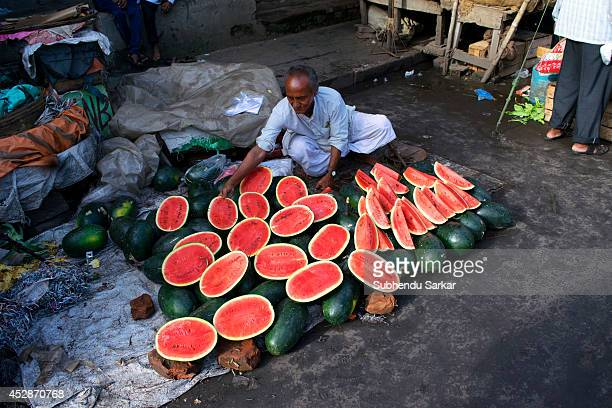 A man sells water melons on the eve of EidulFitr in the streets of central Kolkata at the end of the month of Ramadan