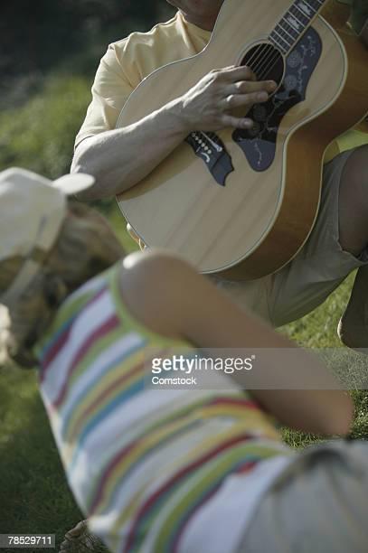 Man serenading woman
