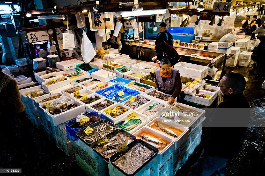 A man serves a customer at the Tsukiji fish market on February 28 2012 in Tokyo Japan Tsukiji fish market is the biggest wholesale fish and seafood...