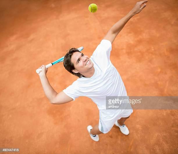 Man serving at tennis