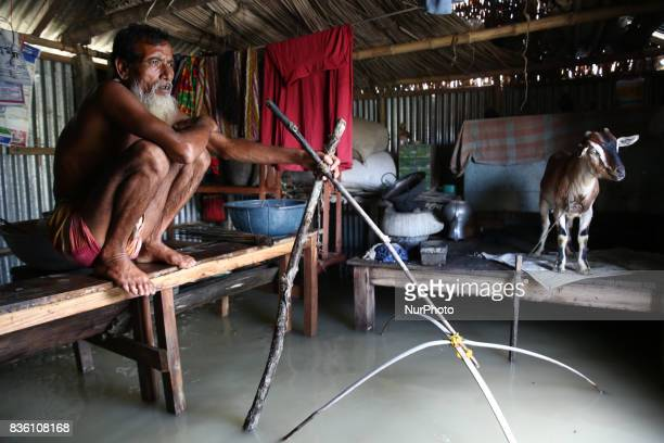 A man sets fishing trap inside his house in Islampur Jamalpur Bangladesh on 19 August 2017