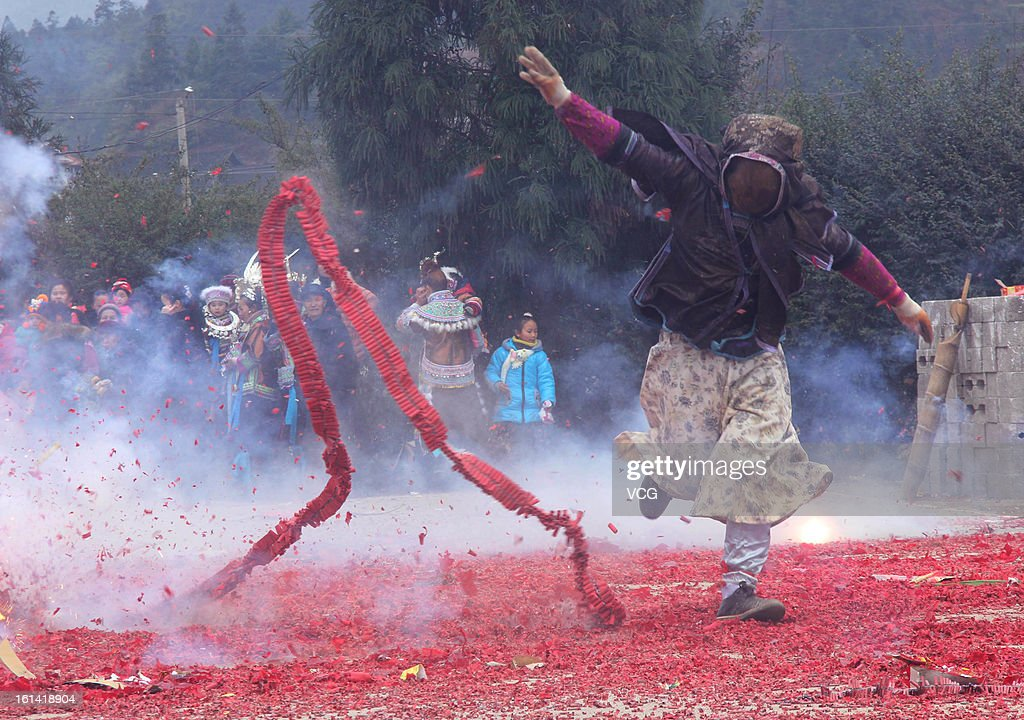 A man sets off fireworks to celebrate Chinese Lunar New Year of Snake on February 10, 2013 in Rongshui, China. The Chinese Lunar New Year of Snake also known as the Spring Festival, which is based on the Lunisolar Chinese calendar, is celebrated from the first day of the first month of the lunar year and ends with Lantern Festival on the Fifteenth day.