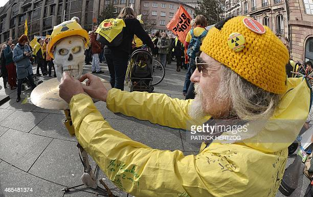 A man sets up a skull and crossbones dummy during a demonstration to protest against the government's nuclear politics in Strasbourg eastern France...