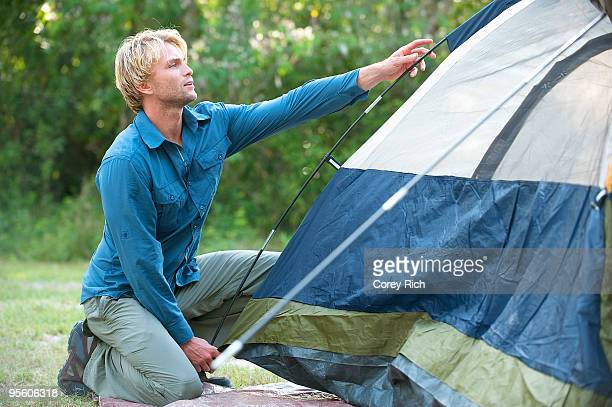 A man sets up a tent in Everglades National Park, Florida.