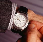 Man setting watch, (Close-up)