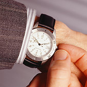 Man setting watch, (Close-up)