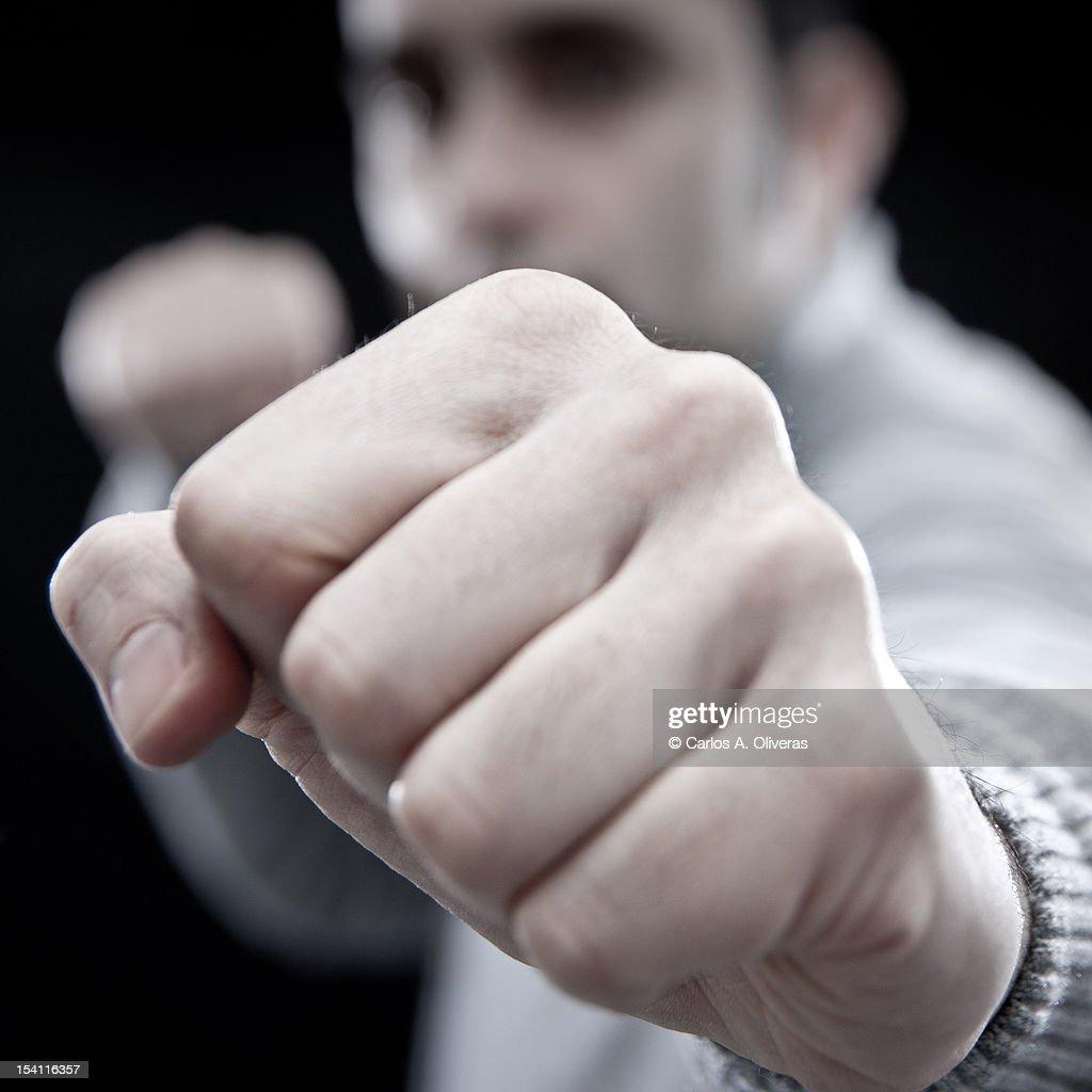 Man shaking fist at camera