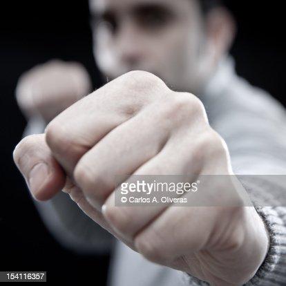 Man shaking fist at camera : Stock Photo
