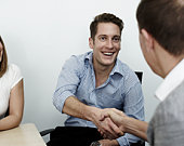 Man shaking hands with colleague at work
