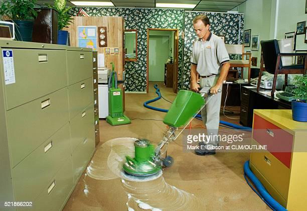 Man Shampooing an Office Carpet