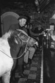 A man shares a pint with his pony Ireland circa 1975