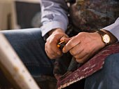 Man sharpening charcoal