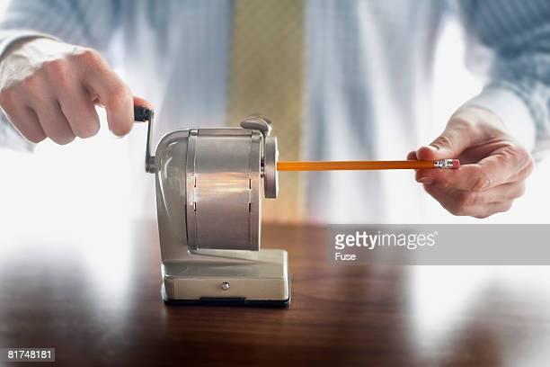Man Sharpening Pencil