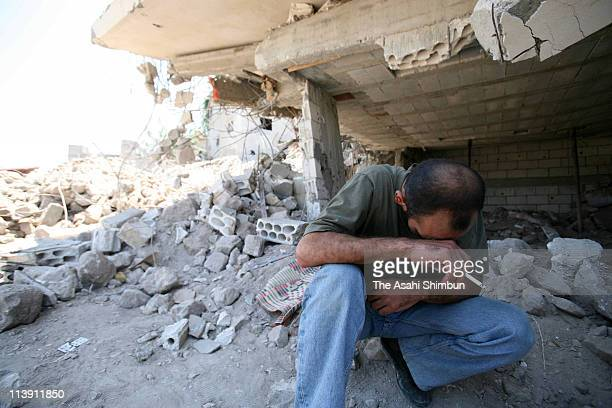 A man sheds tears at the destroyed city by Israeli air attack on July 31 2006 in Qana Lebanon