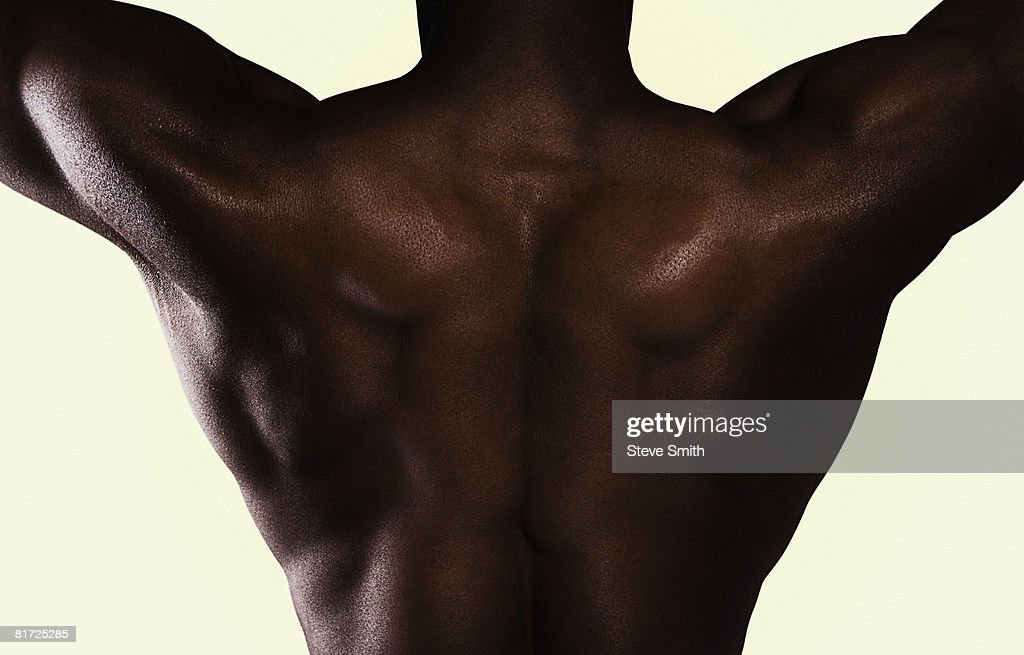 Man shirtless with arms up : Stock Photo