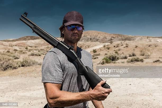 Man Shooting A 12 Gauge Shotgun