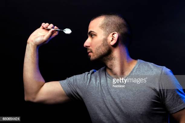 Man shooting darts