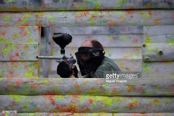 A man shoots with a paintball marker at the Gotcha playground on May 21 2009 in Vysocany Czech Republic The German government has abandoned its plan...