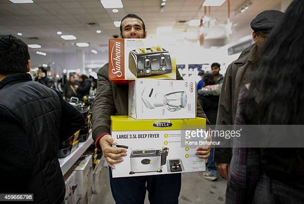 A man shop at the JCPenney store at the Newport Mall on November 27 2014 in Jersey City New Jersey Black Friday sales which now begin on the Thursday...
