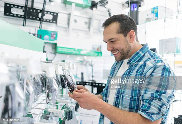Man shopping at a tech store