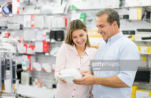 Man shopping at a tech store
