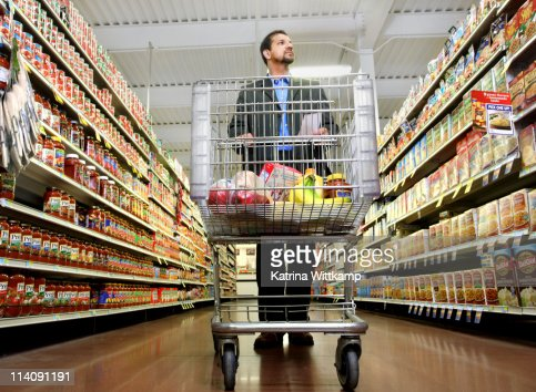 Man shopping for groceries. : Stock Photo
