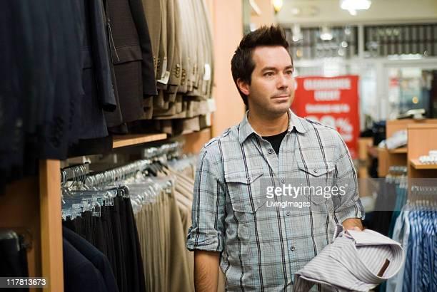 Man shopping in a men's wear store